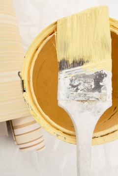 Yellow paint with brush